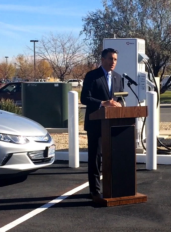 Governor Brian Sandoval and officials celebrate the second Nevada Electric Highway charging stations to go operational during a ribbon cutting ceremony in Fallon, Nevada. The highway is expanding the state's electric vehicle charging station infrastructure.